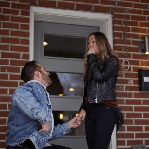 E.J. gets down on one knee to propose to Chelsea on the front porch of the new house they won with Accept.inc